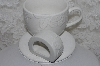 "**MBAMG #003-235   ""Set Of 8/ 4 Coffee Cups & 4 Napkin Rings/ White Ceramic/Poinsettia Pattern"""
