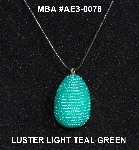 "MBA #AE3-0078  ""Luster Light Teal Green Glass Seed Bead Egg Pendant"""