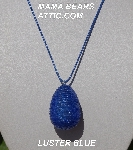 "MBA #5557-0049  ""Luster Blue Glass Seed Bead Egg Pendant"""