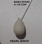 "MBA #5557-0084  ""Pearl White Glass Seed Bead Egg Pendant"""
