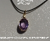 "MBA #5600-346  ""Bezel Set Fancy Cut Oval Amethyst Pendant With 18"" Black Cord"""