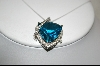** 18K White Gold Fancy Trillion Cut Blue Topaz & Diamond Pendant
