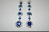 **Created Blue Sapphire Dangle Pierced  Earrings