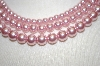 **  Triple Strand Pink Glass Pearl Necklace