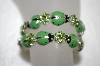 **MBA #16-530  Set Of 3 Stretch Green Enameled LadyBug & Green Crystal Bracelets