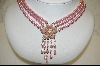 **Majestic Simulated Pink  Pearl Three Strand Necklace