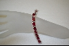 **Charles Winston Oval Cut Created Ruby & Clear Cz Bracelet