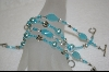 **Set of 4 Hand Beaded Aqua Blue Bracelets