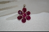 **  7 Stone Over Cut Ruby Flower Pendant