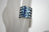 **MBA #21-299  Platinum Plated Silver Created Blue Sapphire Tonal Ring