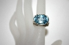 **MBA #21-128  Sterling/18K Blue Topaz Ring