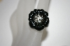 Angelique De Paris Black Resin Flower Ring With Clear Topaz Center