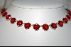 **  27 Stone Red Glass Necklace