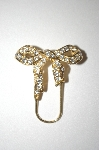 **  Monet Gold Tone Clear Crystal Bow Pin