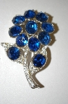 **MBA #25-767  Coro Rhodium Plated Blue Rhinestone Flower Pin