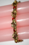 **MBA #25-334  Vintage Gold Tone Red Rhinestone Stretch Bracelet