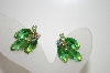 **MBA #6-0978   Vintage Gold Tone Green Rhinestone Clip On Earrings