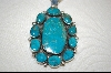 """ Oval 11 Stone Turquoise Pendant"