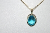 "**MBA #80-0079  14k Yellow Gold Oval Cut Blue Topaz Pendant With 18"" Chain"