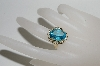**MBA #80-0087  14K Yellow Gold Oval Cut Blue Topaz Ring