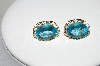 **MBA #80-0074     14k Yellow Gold Oval Cut Blue Topaz Earrings