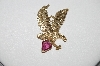 **MBA #85-208     14K Yellow Gold Custom Made Eagle Pendant With Fancy Cut Tourmaline