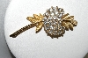 Trifari Gold Tone Crystal Rhinestone Flower Brooch