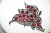 **MBA #87-301   Sarah Coventry Silvertone Red AB Crystal Fancy Leaf Brooch