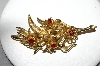 **MBA #87-290   Brooks Goldtone Red Rhinestone Flower Brooch