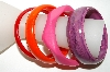 **Set Of 4 Multi Colored Lucite Bangle Bracelets