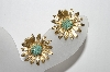 **MBA #88-246   Les Bernard Gold Plated Blue Stone Center Flower Clip On Earrings
