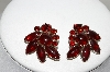 **MBA #87-053   Silver Tone Red Glass & Rhinestone Clip On Earrings