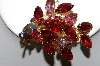 +MBA #87-036   Gold Tone Red, Pink & AB  Rhinestone Brooch