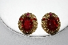 **MBA #87-042   Made In West Germany Gold Tone Red Rhinestone Clip On Earrings