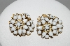 """SOLD""  MBA #96-008   ""Amourelle Goldtone White Milk Glass Clip On Earrings"""