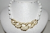 "MBA #94-304  ""Napier Goldtone White Bead Necklace With Enameled Center Piece"""