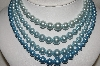 "MBA #E49-187   ""Vintage 4 Strand Blue Faux Pearl Necklace"""