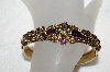 "MBA #E52-206   ""Avon Antiqued Goldtone Purple Rhinestone Hinged Cuff Bracelet"""