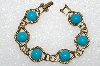"**MBA #E56-075   ""Older Antiqued Goldtone Blue Acrylic Stone Bracelet"""