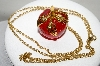 "MBA #88-092  ""Vintage Avon Red Lucite Apple Pendant With 32"" Chain"""