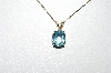 "**MBA #87-221  ""14K Yellow Gold Set Oval Blue Topaz Pendant With 16"" Chain"""