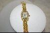 *Nolan Miller's Gold Toned  Pave Panther Link Watch