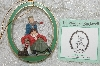 """SOLD""  MBAB #29-027  ""Norman Rockwell ""Skating Lesson"" Ornament"""